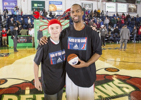 Kam Taylor with Super Fan after one of The Red claws victories. Taylor ended up with 20pts 4ast 4stls